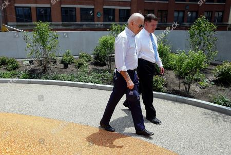 Joe Biden, Marty Walsh. Former vice president and Democratic presidential candidate Joe Biden walks, beside Boston Mayor Marty Walsh, right, in a park in being constructed in Boston in honor of Martin Richard, the youngest victim of the 2013 Boston Marathon bombings