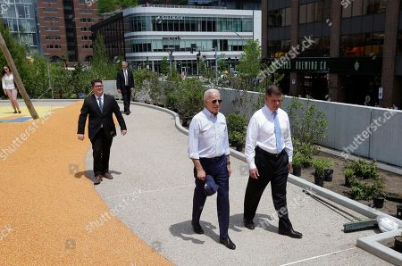 Joe Biden,Marty Walsh. Former vice president and Democratic presidential candidate Joe Biden, second from right, walks, beside Boston Mayor Marty Walsh, right, in a park in being constructed in Boston in honor of Martin Richard, the youngest victim of the 2013 Boston Marathon bombings