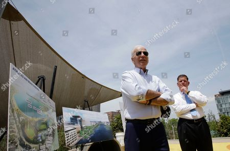Joe Biden,Marty Walsh. Former vice president and Democratic presidential candidate Joe Biden speaks with reporters, beside Boston Mayor Marty Walsh, right, and renderings of Boston, left, while visiting a park in Boston being constructed in honor of Martin Richard, the youngest victim of the 2013 Boston Marathon bombings