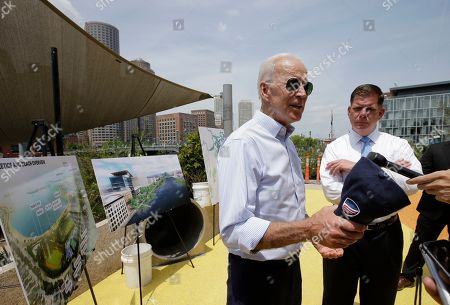 Stock Image of Joe Biden,Marty Walsh. Former vice president and Democratic presidential candidate Joe Biden speaks with reporters, beside Boston Mayor Marty Walsh, right, and renderings of Boston, left, while visiting a park in Boston being constructed in honor of Martin Richard, the youngest victim of the 2013 Boston Marathon bombings
