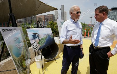 Joe Biden,Marty Walsh. Former vice president and Democratic presidential candidate Joe Biden, center, speaks with Boston Mayor Marty Walsh, right, while standing near renderings of Boston, left, while visiting a park in Boston being constructed in honor of Martin Richard, the youngest victim of the 2013 Boston Marathon bombings