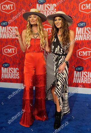 Ruby Stewart, Alyssa Bonagura. Ruby Stewart, left, and Alyssa Bonagura of The Sisterhood Band arrive at the CMT Music Awards, at the Bridgestone Arena in Nashville, Tenn