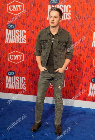Travis Denning arrives at the CMT Music Awards, at the Bridgestone Arena in Nashville, Tenn