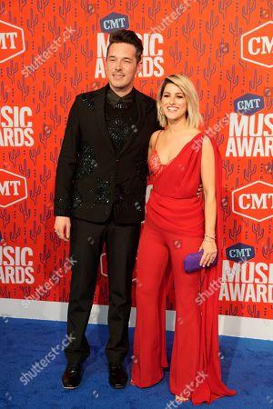 Stock Picture of Sam Palladio, Cassadee Pope. Sam Palladio, left and Cassadee Pope arrive at the CMT Music Awards, at the Bridgestone Arena in Nashville, Tenn
