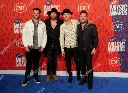 Stock Picture of Chris Thompson, James Young, Jon Jones, Mike Eli. Chris Thompson, from left, James Young, Jon Jones, and Mike Eli, of the Eli Young Band, arrive at the CMT Music Awards, at the Bridgestone Arena in Nashville, Tenn