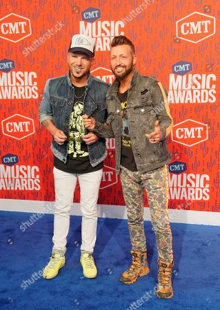 Chris Lucas, Preston Brust. Chris Lucas, left, and Preston Brust of LOCASH arrive at the CMT Music Awards, at the Bridgestone Arena in Nashville, Tenn