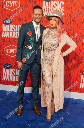 Tyler Cain, Meghan Linsey. Tyler Cain, left, and Meghan Linsey arrives at the CMT Music Awards, at the Bridgestone Arena in Nashville, Tenn