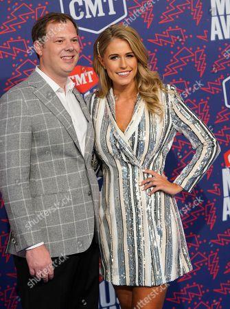 Brian Parker, left, and Jillian Cardarelli arrive at the CMT Music Awards, at the Bridgestone Arena in Nashville, Tenn