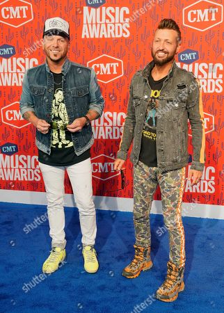 Chris Lucas, Preston Brust. Chris Lucas, left, and Preston Brust, of LoCash, arrive at the CMT Music Awards, at the Bridgestone Arena in Nashville, Tenn