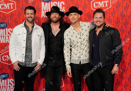 Stock Image of Chris Thompson, James Young, Jon Jones, Mike Eli. Chris Thompson, from left, James Young, Jon Jones, and Mike Eli, of the Eli Young Band, arrive at the CMT Music Awards, at the Bridgestone Arena in Nashville, Tenn