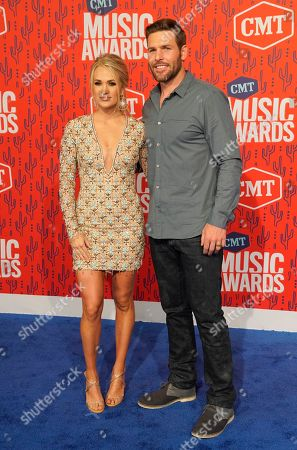 Carrie Underwood, Mike Fisher. Carrie Underwood, left, and Mike Fisher arrive at the CMT Music Awards, at the Bridgestone Arena in Nashville, Tenn