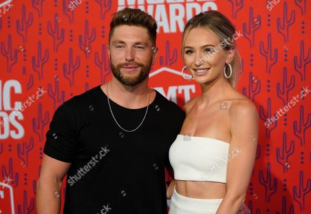 Chris Lane, Lauren Bushnell. Chris Lane, left, and Lauren Bushnell arrive at the CMT Music Awards, at the Bridgestone Arena in Nashville, Tenn