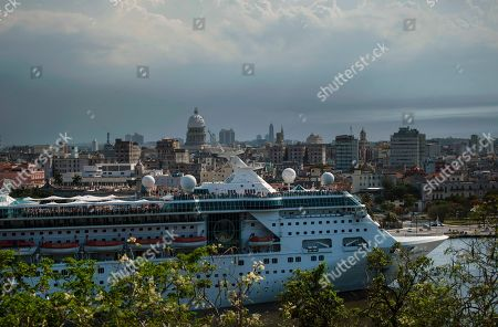 The Empress of the Seas, a Royal Caribbean vessel, leaves the harbor in Havana, Cuba, . Major cruise lines on Wednesday immediately began dropping stops in Cuba from their itineraries and hastily rerouting ships to other destinations including Mexico, after the Trump administration's new restrictions on travel to Cuba