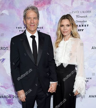 David E. Kelley, Michelle Pfeiffer. Writer and producer David E. Kelley, left and wife actress Michelle Pfeiffer attend the Fragrance Foundation Awards at the David H. Koch Theater at Lincoln Center, in New York