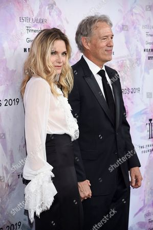 Michelle Pfeiffer, David E. Kelley. Actress Michelle Pfeiffer, left, and husband David E. Kelley attend the Fragrance Foundation Awards at the David H. Koch Theater at Lincoln Center, in New York