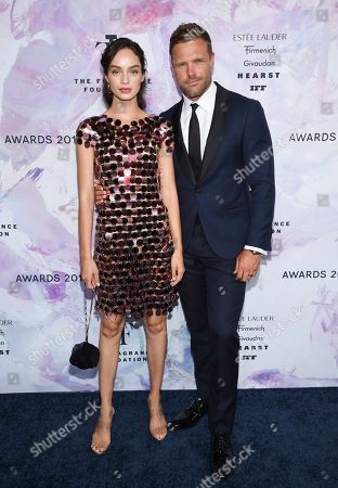 Stock Picture of Luma Grothe, Nick Youngquest. Models Luma Grothe, left, and Nick Youngquest attend the Fragrance Foundation Awards at the David H. Koch Theater at Lincoln Center, in New York