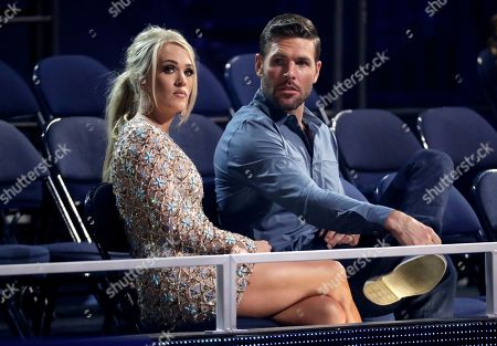 Carrie Underwood, Mike Fisher. Carrie Underwood, left, and Mike Fisher appear in the audience at the CMT Music Awards, at the Bridgestone Arena in Nashville, Tenn