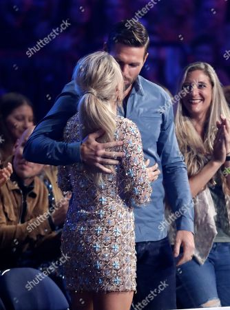 """Carrie Underwood, Mike Fisher. Mike Fisher, right, kisses Carrie Underwood, before she goes on stage to accept the award for female video of the year for """"Love Wins"""" at the CMT Music Awards, at the Bridgestone Arena in Nashville, Tenn"""