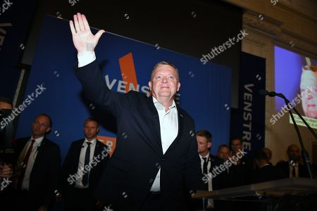 Danish Prime Minister Lars Loekke Rasmussen (C) of the liberal party waves after the election results were announced during the Parliamentary Elections, at Christiansborg Castle in Denmark, 05 June 2019.