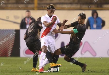 Andre Carrillo, Joel Campell, Celso Borges. Peru's Andre Carrillo, center, fights for the ball with Costa Rica's Joel Campell, left, and Celso Borges, during a friendly soccer match at the Monumental stadium in Lima, Peru