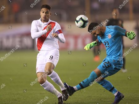 Paolo Guerrero, Leonel Moreira. Costa Rica's goalkeeper Leonel Moreira heads the ball against Peru's Paolo Guerrero, during a friendly soccer match at the Monumental stadium in Lima, Peru
