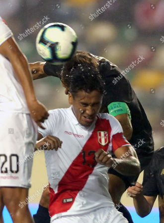 Peru's Renato Tapia (front) vies for the ball with Costa Rica's Celso Borges (back) during a friendly soccer match between Peru and Costa Rica at Monumental U stadium in Lima, Peru, 05 June 2019.
