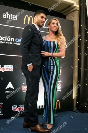 Uruguayan national soccer team player Luis Suarez (L) and his wife Sofia Balbi (R) pose during the second Celeste Foundation gala dinner in Montevideo, Uruguay, 05 June 2019. The players of the Uruguayan national soccer squad participated in the gala dinner of the Celeste Foundation.