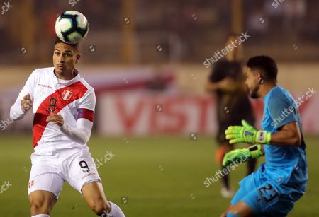 Stock Photo of Paolo Guerrero (L) of Peru in action against Costa Rica goalkeeper Leonel Moreira (R) during a friendly soccer match between Peru and Costa Rica at Monumental U stadium in Lima, Peru, 05 June 2019.