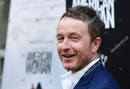 "Jake Scott, director of ""American Woman,"" poses at the premiere of the film at the ArcLight Hollywood, in Los Angeles"