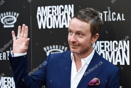 "Stock Image of Jake Scott, director of ""American Woman,"" poses at the premiere of the film at the ArcLight Hollywood, in Los Angeles"
