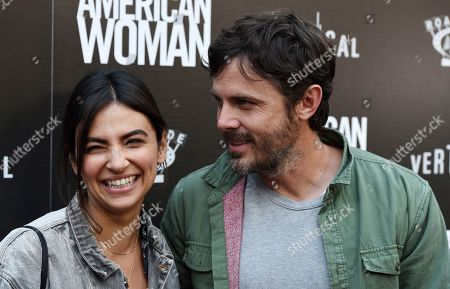 """Casey Affleck, Floriana Lima. Actor Casey Affleck, right, and his girlfriend Floriana Lima pose together at the premiere of the film """"American Woman"""" at the ArcLight Hollywood, in Los Angeles"""