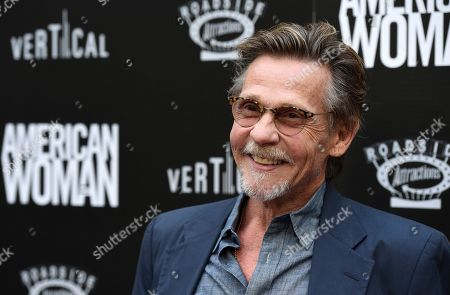 """Dennis Christopher poses at the premiere of the film """"American Woman"""" at the ArcLight Hollywood, in Los Angeles"""