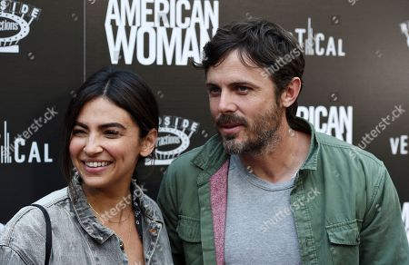 """Casey Affleck, Floriana Lima. Actor Casey Affleck, right, and his girlfriend Floriana Lima arrive at the premiere of the film """"American Woman"""" at the ArcLight Hollywood, in Los Angeles"""