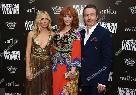 "Jake Scott, Christina Hendricks, Sienna Miller. Jake Scott, right, director of ""American Woman,"" poses with cast members Sienna Miller, left, and Christina Hendricks at the premiere of the film at the ArcLight Hollywood, in Los Angeles"