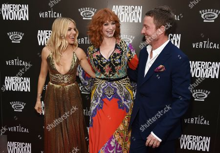 "Sienna Miller, Christina Hendricks, Jake Scott. Sienna Miller, left, and Christina Hendricks, cast members in ""American Woman,"" greet the film's director Jake Scott at the premiere of the film at the ArcLight Hollywood, in Los Angeles"