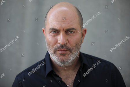 """One of the creators of Israel's hit TV show """"Fauda"""" Lior Raz poses for a photo in Tel Aviv, Israel. After two successful seasons, co-creators Avi Issacharoff and Raz are hard at work on their much-anticipated third season, a good portion of which takes place in the Gaza Strip. The season debut date for the Netflix hit hasn't been revealed, but the trailer is being released this week"""