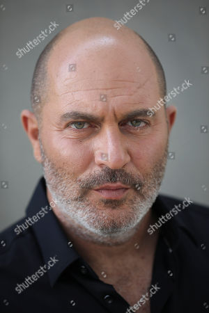 """One of the creator of Israel's hit TV show """"Fauda"""" Lior Raz poses for a photo in Tel Aviv, Israel. After two successful seasons, co-creators Avi Issacharoff and Lior Raz are hard at work on their much-anticipated third season, a good portion of which takes place in the Gaza Strip. The season debut date for the Netflix hit hasn't been revealed, but the trailer is being released this week"""