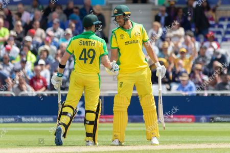 Steve Smith & Nathan Coulter-Nile shake hands on achieving 100 partnership during the ICC Cricket World Cup 2019 match between Australia and West Indies at Trent Bridge, West Bridgford, United Kingdom