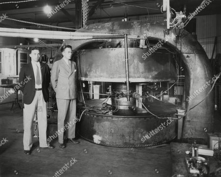 Stanley Livingston (left) and Ernest Lawrence with the 27-inch cyclotron in 1934. At the Radiation Laboratory at the University of California, Berkeley in 1934. As graduate student, Livingston translated the concept of the atom smasher into working hardware. -