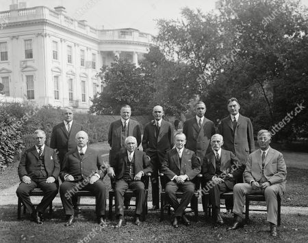 President Calvin Coolidge with his Cabinet, Oct. 13, 1925. Seated, L-R: Harry New, Postmaster; John Weeks, Sec. of War; Frank Kellogg, Sec. of State; President Coolidge; Andrew Mellon, Treasury Sec.; John Sargent, Attn. General. Standing, L-R: James Davis, Labor Sec.; Herbert Hoover, Commerce Sec.; William Jardine, Agriculture Sec.; Herbert Work, Interior Sec.; Curtis Wilbur, Navy Sec.