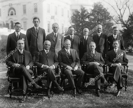 Herbert Hoover with his Cabinet and Vice President Charles Curtis. Seated, L-R: Ogden Mills, Treasury; Charles Curtis, VP; President Hoover; Henry Stimson, State; Patrick Hurley, War. Standing, L-R: William Doak, Labor; Ray Wilbur, Interior; William DeWitt, Attorney General; Walter Brown, Postmaster Gen.; Charles F. Adams, Navy; Robert Lamont, Commerce; Arthur Hyde, Agriculture. Ca. 1932.