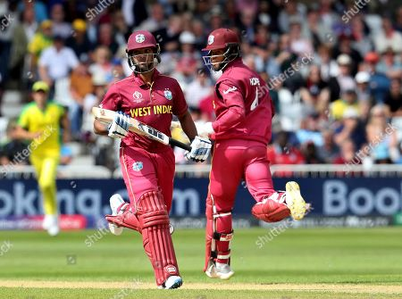 West Indies' Nicholas Pooran, left, and Shai Hope run between the wickets to score during the Cricket World Cup match between Australia and West Indies at Trent Bridge in Nottingham