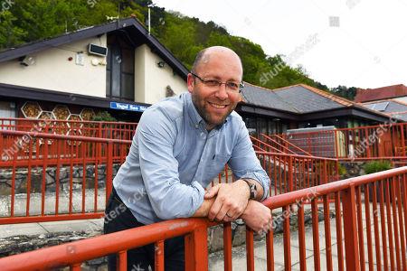 Stock Photo of UK's Most Eco Friendly School. - Head Teacher Ian Jones. - Year 6 Pupils From Ysgol San Sior School Llandudno North Wales.- 8/5/18.