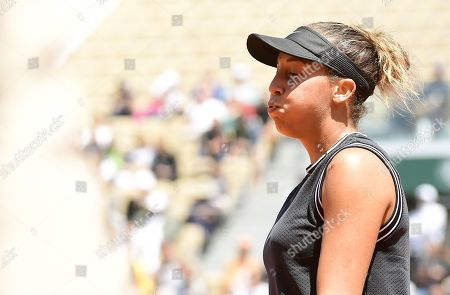 Madison Keys of the USA reacts as she plays Ashleigh Barty of Australia during their women?s quarter final match during the French Open tennis tournament at Roland Garros in Paris, France, 06 June 2019.