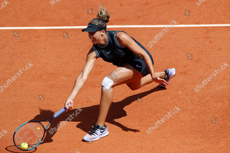 Madison Keyes of the U.S. plays a shot against Australia's Ashleigh Barty during their quarterfinal match of the French Open tennis tournament at the Roland Garros stadium in Paris