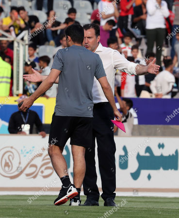 Iran's head coach Marc Wilmots talks to his assistance coach Vahid Hashemian (L) before  the friendly soccer match between Iran and Syria at the Azadi stadium in Tehran, Iran, 06 June 2019.