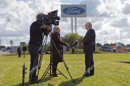 Former First Minister for Wales Carwyn Jones is interviewed by a tv crew outside the Ford engine plant in Bridgend