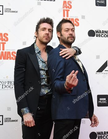 Stock Photo of Miles Kane (L) and Kasabian band singer Tom Meighan (R) pose for photographs as he arrives for the film premiere of 'As It Was' at Alexander Palace in London, Britain, 06 June 2019. The documentary focusses on British singer Liam Gallagher's solo career.
