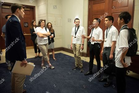 Urbana, Ill. students and national winners of the 27th annual ExploraVision science competition, from right, Ryan Wang, Shoorsen Gandi, Benjamin Chang and Nathanael Jones, meet with Sam Coffey, a Legislative Correspondent with Sen. Dick Durbin, D-Ill., left, to talk about their winning project at the Capitol, in Washington. The contest is sponsored by Toshiba and administered by the National Science Teachers Association