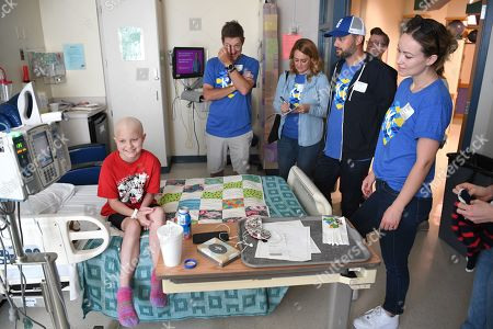 Kevin Rahm, Nate Bargatze and Olivia Wilde and a Children's Mercy Hospital patient